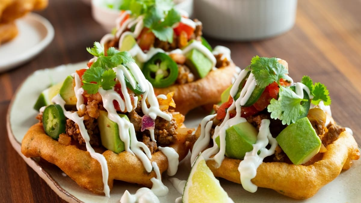 These unique tacos are served on savory deep-fried funnel cakes.